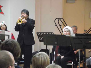 conductor Tak plays his trumpet