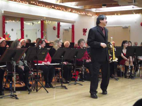 Christmas concert with conductor Tak playing with the band